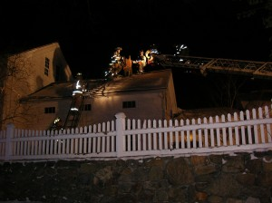 Hawleyville and Hook and Ladder firefighters on roof