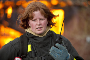 Female-firefighter-in-front-of-structure-fire-000016975455_Medium