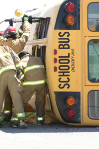 Firemen-rescuing-students-from-wrecked-school-bus-000021882654_Medium
